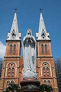 The 19th century Notre Dame Cathedral and statue of the Virgin Mary in Ho Chi MInh City, Vietnam, Southeast Asia
