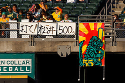 June 29, 2011; Oakland, CA, USA; Fans of Oakland Athletics designated hitter Hideki Matsui (not pictured) hang signs in anticipation of his 500th professional career home run during the first inning against the Florida Marlins the game at the O.co Coliseum.  Matsui entered the game with 499 home runs from his career in Major League Baseball and professional baseball in Japan.