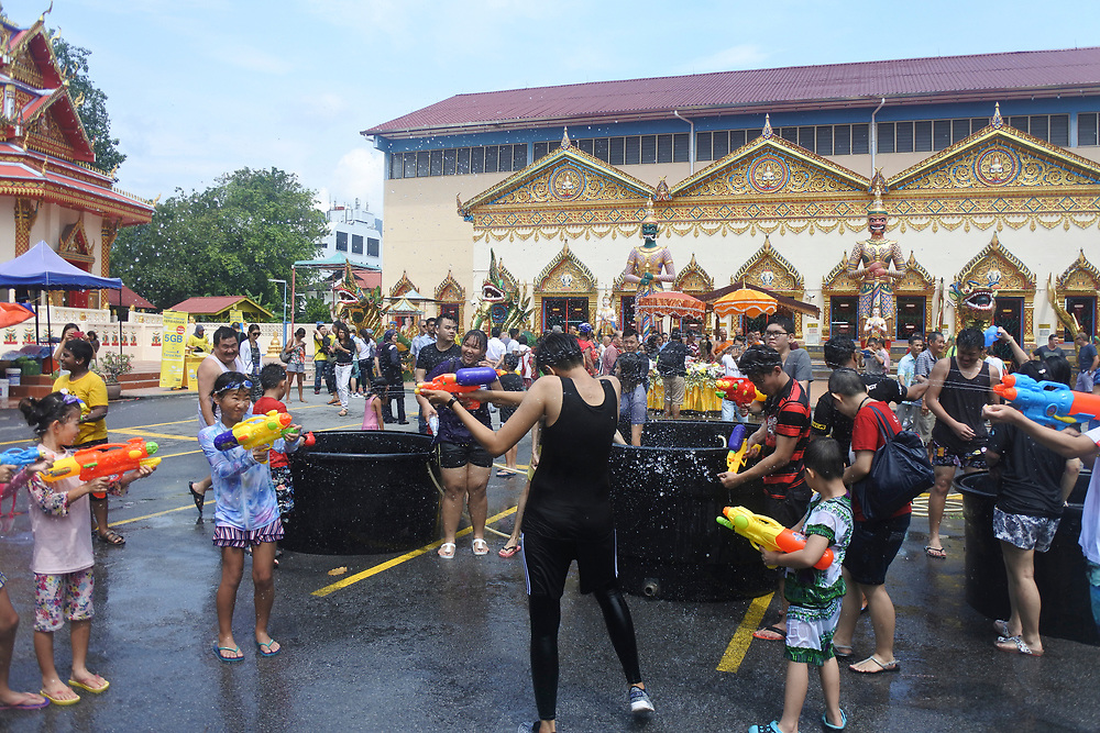 Young people at a water pistol fight at the Songkran festival