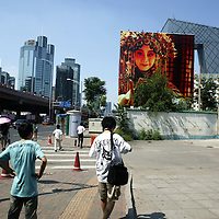 BEIJING, AUGUST - 2 : a Beijing Opera poster in front of the new CCTV tower .