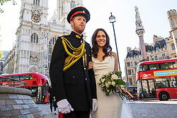 © Licensed to London News Pictures. 14/05/2018. London, UK. Lookalikes of Prince Harry and Meghan Markle pose for photographs outside Westminster Abbey one week before the Royal Wedding will take place in Windsor. Photo credit: Rob Pinney/LNP