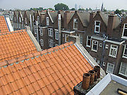 looking out over roof tops of typical Amsterdam houses, between Gerard Doustraat and Albert Cuypstraat