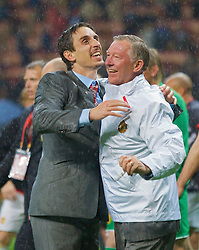MOSCOW, RUSSIA - Wednesday, May 21, 2008: Manchester United's manager Alex Ferguson and Gary Neville celebrate after beating Chelsea on sudden death penalties during the UEFA Champions League Final at the Luzhniki Stadium. (Photo by David Rawcliffe/Propaganda)