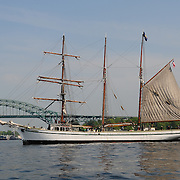 Tall ship Gazela as it passes in front of the Piscataqua River Bridge (I-95)