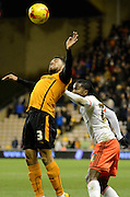 Scott Golbourne wins a header during the Sky Bet Championship match between Wolverhampton Wanderers and Fulham at Molineux, Wolverhampton, England on 24 February 2015. Photo by Alan Franklin.