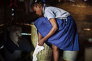 Natacha Etienne, 12, gets ready for school inside the small, two-room home she shares with her parents and siblings in Loncy village, Haiti.