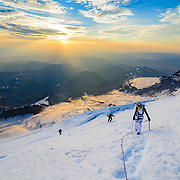 Mountaineers navigates Mount Rainier in the early morning