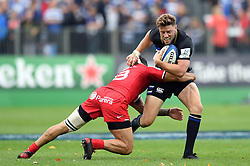 Rhys Priestland of Bath Rugby takes on the Toulouse defence - Mandatory byline: Patrick Khachfe/JMP - 07966 386802 - 13/10/2018 - RUGBY UNION - The Recreation Ground - Bath, England - Bath Rugby v Toulouse - Heineken Champions Cup