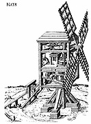 Post mill: Sectional view of windmill showing grain being fed into millstones in centre. On left of mill, sack of grain is being hoisted top of building.  In this design of mill the whole structure was rotated on post, R, to bring the sails into the wind.   From German edition of Agostino Ramelli 'Le diverse et artificiose machine' published 1620. Engraving.