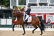 Emmelie Scholtens - Borencio<br /> FEI World Breeding Dressage Championships for Young Horses 2012<br /> © DigiShots