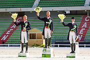 Podium Grand Prix Special 1. Carl Hester - Nip Tuck, 2. Gareth Hughes - DV Stenkjers Nadonna, 3. Nathalie zu Sayn Wittgenstein - Fabienne<br /> Test Event WEG Normandie 2014<br /> © DigiShots