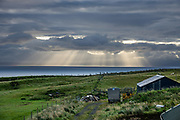 Morning rays of sun seen from Digg village, near Staffin, Isle of Skye, Scotland, UK, Europe.