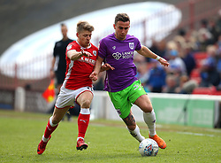 Joe Bryan of Bristol City takes on Lloyd Isgrove of Barnsley - Mandatory by-line: Robbie Stephenson/JMP - 30/03/2018 - FOOTBALL - Oakwell Stadium - Barnsley, England - Barnsley v Bristol City - Sky Bet Championship