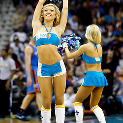 January 24,  2011; New Orleans, LA, USA; New Orleans Hornets Honeybees dancers perform during the second half of a game against the Oklahoma City Thunder at the New Orleans Arena. The Hornets defeated the Thunder 91-89. Mandatory Credit: Derick E. Hingle