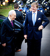 1-10-2013 THE HAGUE - Israeli President Shimon Peres  meets Dutch King Willem Alexander at the Noordeinde palace . Israeli President Shimon Peres is slated to become the first foreign head of state to meet with the new monarch of the Netherlands .Peres is scheduled to meet King Willem-Alexander on tuesday and deliver a speech at the Dutch parliament. COPYRIGH ROBIN UTRECHT
