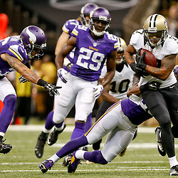 Sep 21, 2014; New Orleans, LA, USA; Minnesota Vikings cornerback Jabari Price (39) tackles New Orleans Saints wide receiver Robert Meachem (17) after a reception during the second half of a game at Mercedes-Benz Superdome. The Saints defeated the Vikings 20-9. Mandatory Credit: Derick E. Hingle-USA TODAY Sports