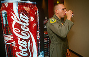 A United States Air Force pilot attending an escape and evasion course at Fairchild AFB, sips from a Coke can.