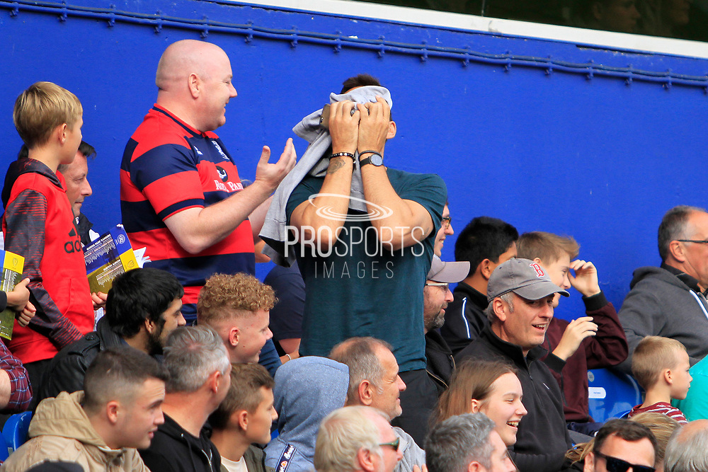 A Queens Park Rangers fan reacts during the EFL Sky Bet Championship match between Queens Park Rangers and Burton Albion at the Loftus Road Stadium, London, England on 23 September 2017. Photo by Richard Holmes.