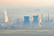 Petrochemical factory and Oil Refinery in smoke and smog. The Inversion layer is visible. Israel, Haifa's industrial area is one of the largest sources of air pollution in the country. Photographed in Haifa Bay, Israel
