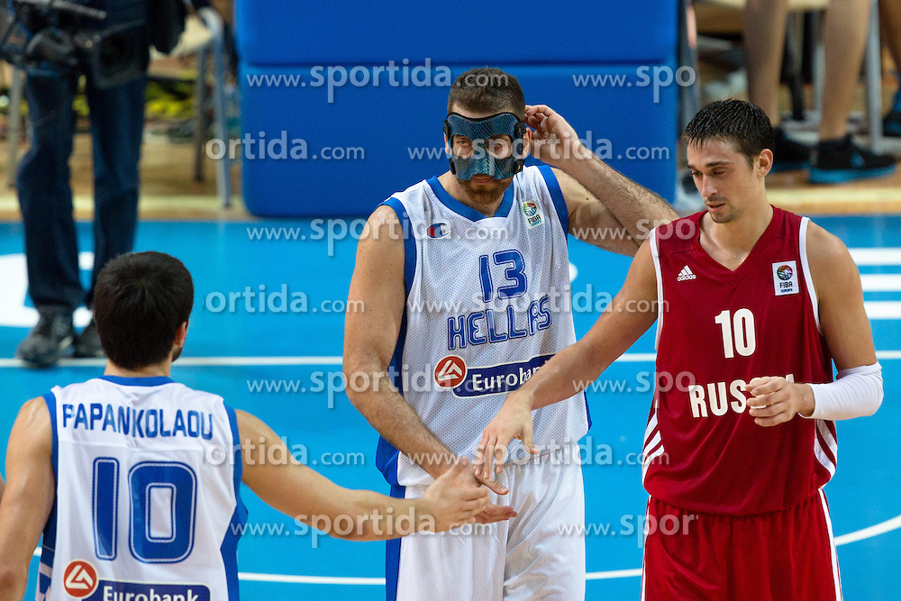Aleksey Shved #10 of Russia greets Kostas Kaimakoglou #13 of Greece and Kostas Papanikolaou #10 of Greece during basketball match between national team of Greece and Russia of Eurobasket 2013 on September 5, 2013 in Arena Bonifika, Koper, Slovenia. (Photo By Matic Klansek Velej / Sportida.com)