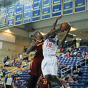 Delaware 87ers Forward Damian Saunders (18) drives towards the basket as Canton Charge Forward Gilbert Brown (4) defends in the first half of a NBA D-league regular season basketball game between the Delaware 87ers (76ers) and The Canton Charge (Cleveland Cavaliers) Friday, Jan 24, 2014 at The Bob Carpenter Sports Convocation Center, Newark, DEL.