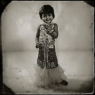 Arisha Islam,3, is the daughter of MD K Islam, 34, and his wife Majue Ani, 25.The family is from Dhaka, Bangladesh. MD K has been in the United States for 11 years and his wife has been here for five years. She wears the special occasion dress called a Lahanga.  (Photo by Robert Falcetti)