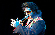 Remember When concert at the Wave Centre, Maryport..A man impersonating and dressed as Elvis Presley sings on stage..Tom Storey as Elvis performs on stage...BEN RUSSELL
