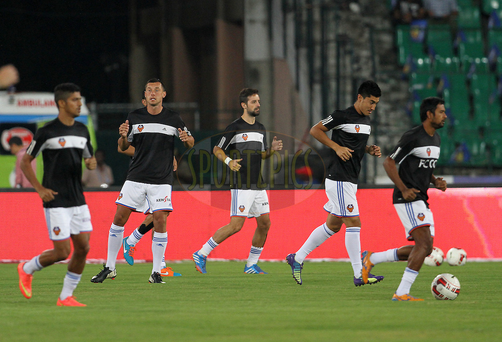 FC Goa warm up before the start of the match 50 of the Hero Indian Super League between Chennaiyin FC and FC Goa held at the Jawaharlal Nehru Stadium, Chennai, India on the 5th December 2014.<br /> <br /> Photo by:  Vipin Pawar/ ISL/ SPORTZPICS