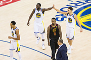 Golden State Warriors forward Draymond Green (23) and Golden State Warriors guard Klay Thompson (11) celerbate a basket against the Cleveland Cavaliers during Game 1 of the NBA Finals at Oracle Arena in Oakland, Calif., on May 31, 2018. (Stan Olszewski/Special to S.F. Examiner)
