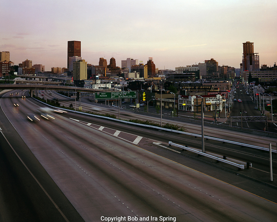 BI52,600-03...WASHINGTON - A 1969 photograph of Interstate 5 passing through downtown Seattle at sunset.