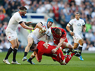 Jack Nowell of England is tackled by Gethin Jenkins of Wales during the RBS 6 Nations match at Twickenham Stadium, Twickenham<br /> Picture by Andrew Tobin/Focus Images Ltd +44 7710 761829<br /> 09/03/2014