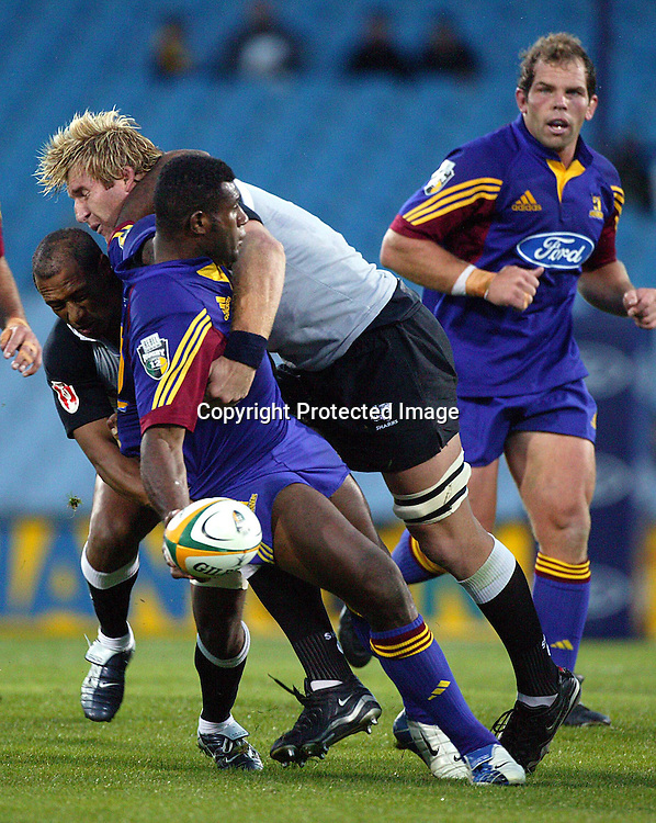 12 March, 2004. Carisbrook Stadium, Otago, New Zealand. Highlanders v Sharks. Seru Rabeni is tackled by AJ Ventor. The Sharks beat the Highlanders 37 to 35.<br />