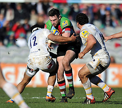 Tom Guest (Harlequins) is tackled in possession - Photo mandatory by-line: Patrick Khachfe/JMP - Tel: Mobile: 07966 386802 01/03/2014 - SPORT - RUGBY UNION - The Twickenham Stoop, London - Harlequins v Worcester Warriors - Aviva Premiership.