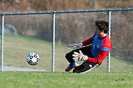 Mt Anthony's Hunter Davis (1) makes a diving save during the boys semifinal soccer game between Mount Anthony and Champlain Valley Union at CVU high school on Tuesday afternoon October 27, 2015 in Hinesburg. (BRIAN JENKINS/ for the FREE PRESS)