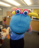 "Volunteer, and Penn Memory Center patient Leslie Wolff shows off one of his puppets Tuesday, September 05, 2017 at CHOP Care Network in Philadelphia, Pennsylvania. The Penn Memory Center, which serves people with dementia mild cognitive disorder, has a new volunteer partnership with CHOP. Its patients and ""normal controls"" volunteer with CHOP patients. (WILLIAM THOMAS CAIN / For The Philadelphia Inquirer)"