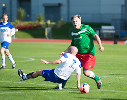 © London News Pictures. 21/09/2013 . Manchester, UK.  British Shadow Chancellor ED BALLS involved in a collision with Northern Echo Parliamentary Lobby Correspondent, ROB MERRICK, which left ROB MERRICK substituted due to injury. Football match between Labour Members of Parliament and journalists in Manchester, on the opening day of the 2014 Labour Party Annual Conference, which is being held in Manchester. Photo credit : Ben Cawthra/LNP