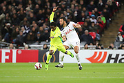 Tottenham Hostpur attacker Moussa Dembele (19) fouling KAA Gent forward Moses Simon (27) during the Europa League match between Tottenham Hotspur and KAA Gent at Wembley Stadium, London, England on 23 February 2017. Photo by Matthew Redman.