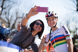 Lizzie Armitstead (Boels-Dolmans Cycling Team) stands in for a selfie with a fan, before the start of the Trofeo Alfredo Binda - a 123.3km road race from Gavirate to Cittiglio on March 20, 2016 in Varese, Italy.