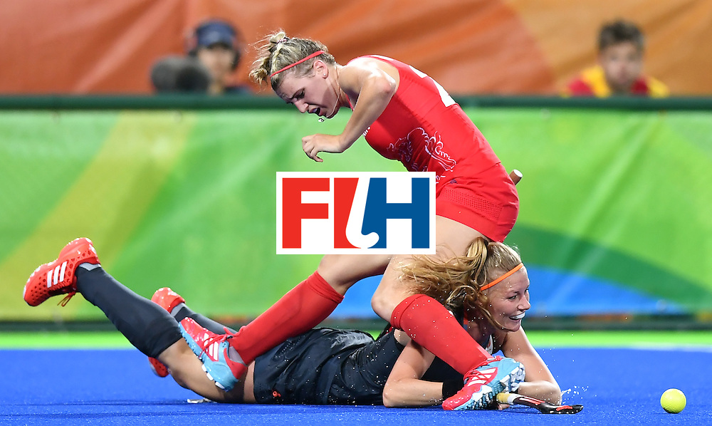 Britain's Lily Owsley (top) falls on Netherlands' Caia van Maasakker during the women's Gold medal hockey Netherlands vs Britain match of the Rio 2016 Olympics Games at the Olympic Hockey Centre in Rio de Janeiro on August 19, 2016. / AFP / MANAN VATSYAYANA        (Photo credit should read MANAN VATSYAYANA/AFP/Getty Images)