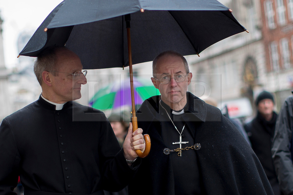 © licensed to London News Pictures. London, UK 16/03/2013. Archbishop of Canterbury the Most Rev Justin Welby (right) conducts a journey from the City of London to Southwark with prayers on Saturday 16 March 2013. Photo credit: Tolga Akmen/LNP