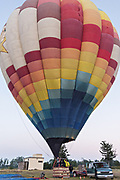 A hot air balloon pilot prepares for take off in a hot air balloon in San Miguel de Allende, Mexico.