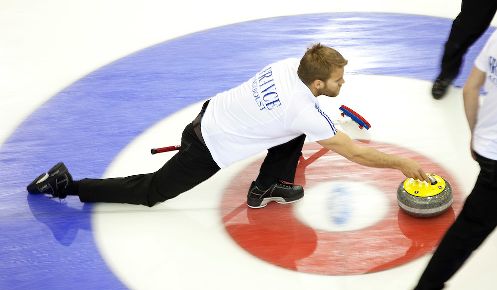 France's third Tony Angiboust delivers his stone during Norway's 5-4 victory over France in a tie breaker at the Ford World Men's Curling Championships in Regina, Saskatchewan, April 8, 2011.<br /> AFP PHOTO/Geoff Robins