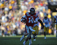 Ole Miss quarterback Bo Wallace (14) scores on a 58 yard run in the  first quarter vs. LSU linebacker Kevin Minter (46) at Tiger Stadium in Baton Rouge, La. on Saturday, November 17, 2012....