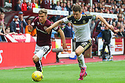 Gavin Reilly out running Ryan Jack during the Ladbrokes Scottish Premiership match between Heart of Midlothian and Aberdeen at Tynecastle Stadium, Gorgie, Scotland on 20 September 2015. Photo by Craig McAllister.