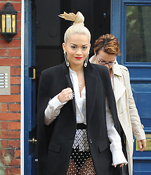 Singer Rita Ora wearing a black sleeveless coat, white shirt and see-through lace skirt with silver balls out and about in London, UK. 08/10/2014<br />