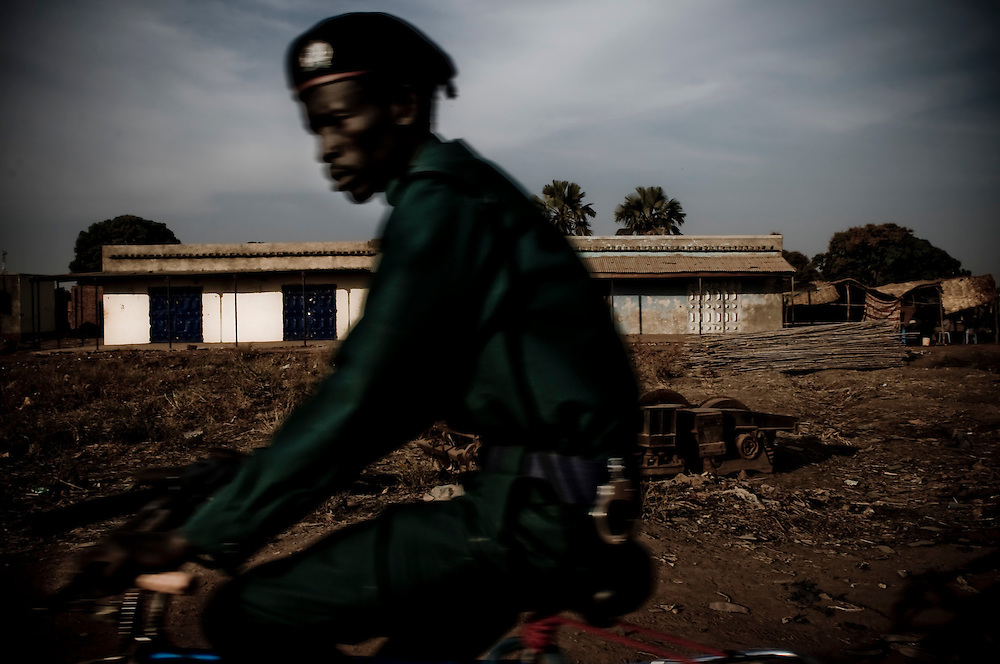 A soldier rides past in the Southern Sudanese town of Aweil. Sudan recently voted on whether or not to remain with the North or to set out alone as the world's newest nation. (© William B. Plowman)