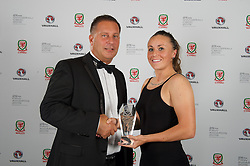 CARDIFF, WALES - Monday, October 5, 2015: Vauxhall's Richard Nix presents Wales' Natasha Harding with the Woman's Fans' Favourite Award during the FAW Awards Dinner at Cardiff City Hall. (Pic by Ian Cook/Propaganda)
