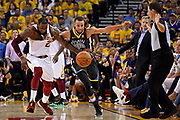 June 3, 2018; Oakland, CA, USA; Golden State Warriors guard Stephen Curry (30) and Cleveland Cavaliers forward LeBron James (23) go for a loose ball during the second quarter in game two of the 2018 NBA Finals at Oracle Arena.