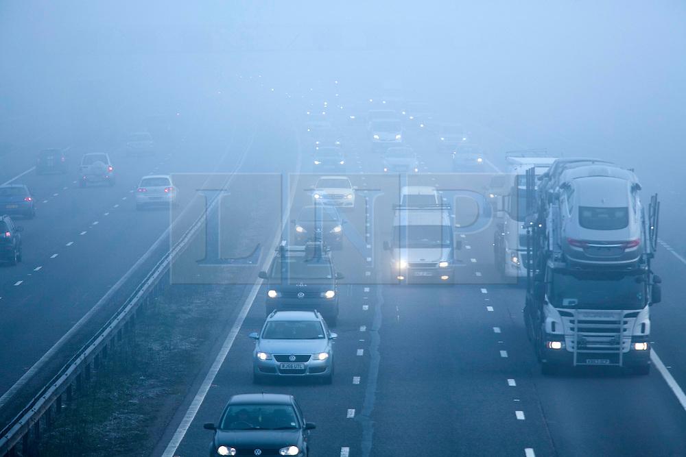 © Licensed to London News Pictures. 14/03/2014. Solihull, West Midlands, UK. Dense fog covered the Midlands earlier today. Pictured, the M42 motorway near Solihull, shrouded in fog. Photo credit : Dave Warren/LNP