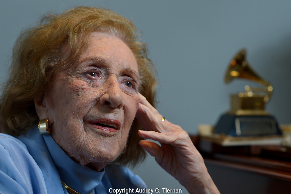 Jazz great Marian McPartland, 95, at the piano in her Port Washinton living room. Note her Grammy award on the piano. (May 27, 2013). © Audrey C. Tiernan